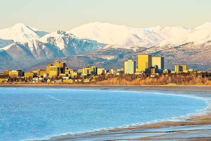 A view of downtown Anchorage as seen from across the bay with the mountains in the back